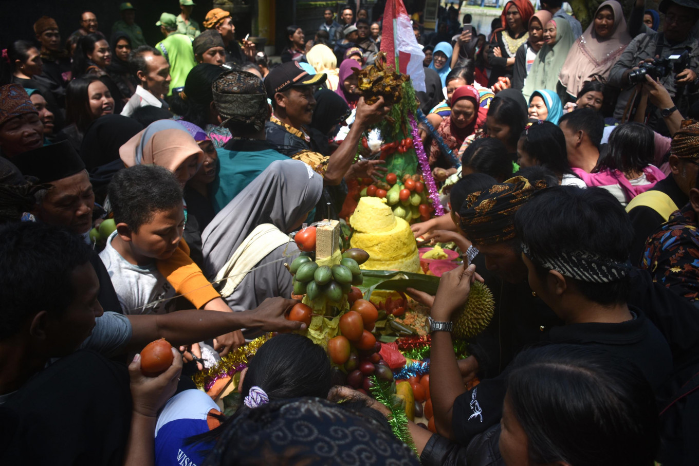 Visitors scramble to get some of the offerings to take home