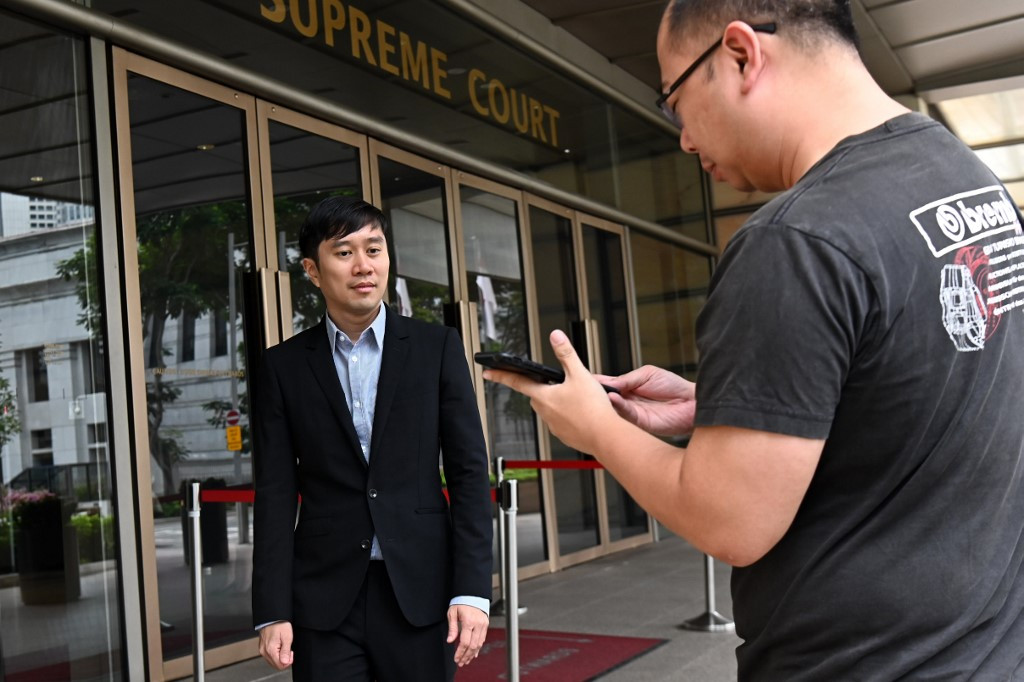Singapore activist fined for Facebook post on courts