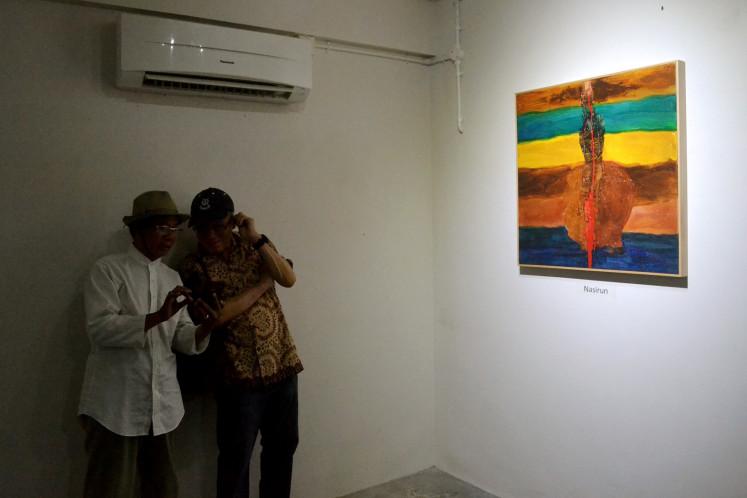 A painting by Yogyakarta artist Nasirun was one of 15 pieces exhibited in