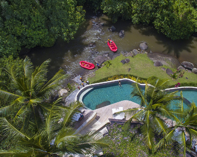 An aerial view of Riverside restaurant, the arrival point for rafting check-in at Four Seasons Resort Sayan