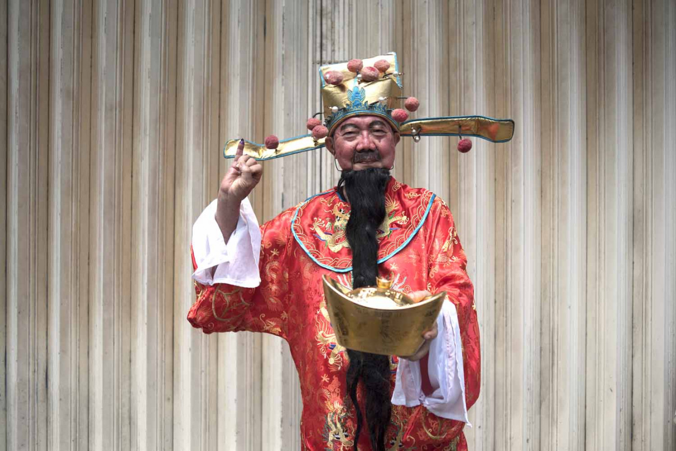 Jay Sen Ye wears a Prosperity God costume for the first time during the election. JP/Rosa Panggabean