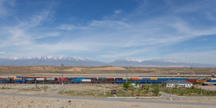 A view of Kazakhstan's Altynkol rail hub on the Kazakh side of the Kazakhstan-Chinese border, with the Dzhungar Alatau mountain range seen in the background, on April 15, 2019.