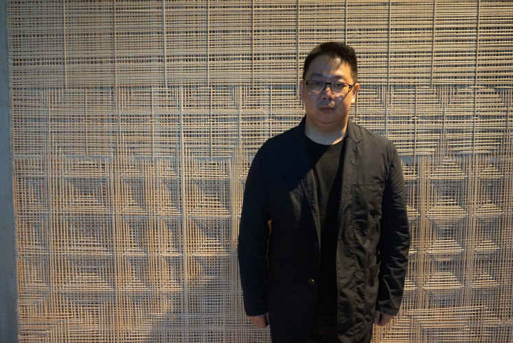 Lim Masulin poses in front of 'Elevation' installation at Museum Macan in West Jakarta on April 12, 2019.