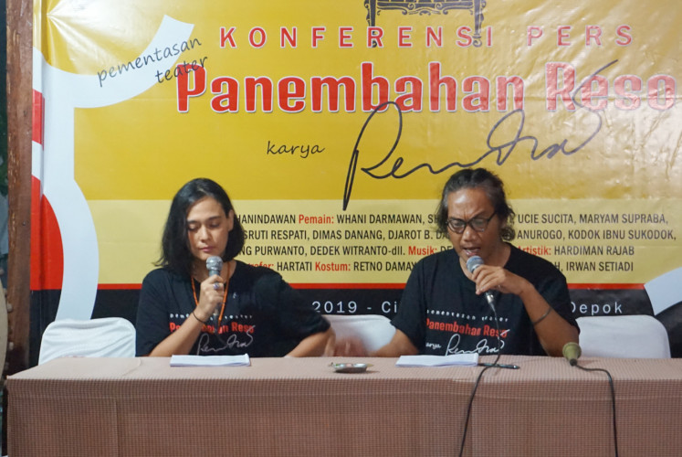 Sha Ine Febriyanti (left) and Whani Darmawan read the play's script during a press conference  at Bengkel Teater Rendra in Depok, West Java, on April 26.