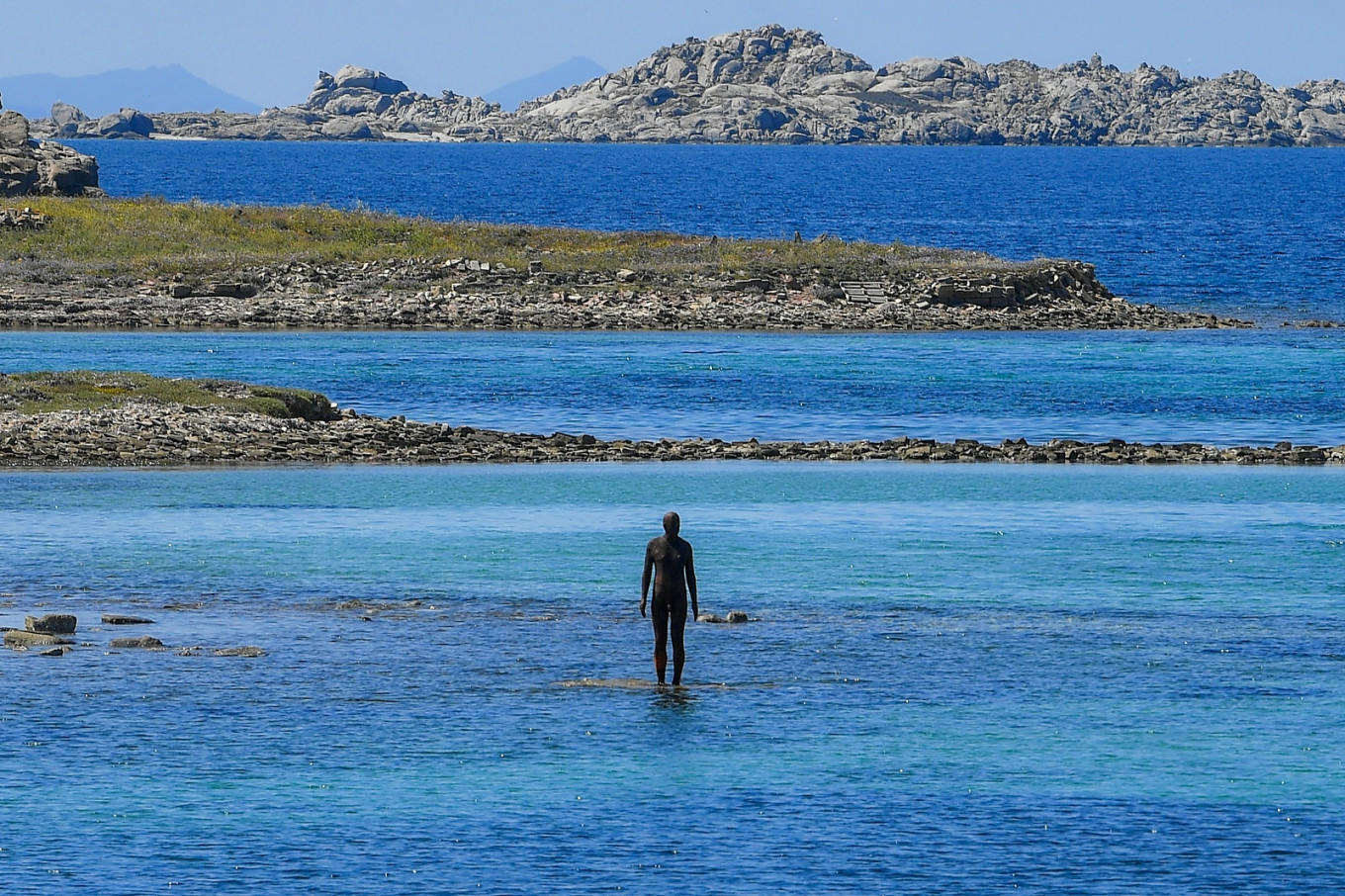 The statue '6 times left' by renowned British artist Antony Gormley, and part of his exhibition 'Sight' stands in the sea at the entrance od the port of the island of Delos, a UNESCO World Heritage Site, on May 3, 2019.