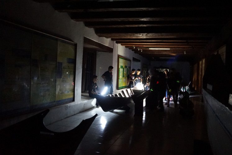 Into the darkness: Participants and guides explore Jakarta's Maritime Museum in the early hours of April 28.