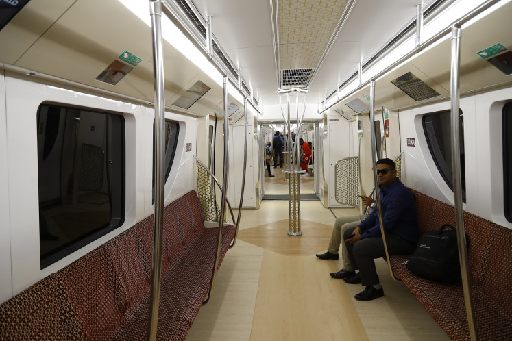 Two commuters are pictured inside one of the carriages of Doha's new Metro Red Line South which was opened on May 8, 2019 in the Qatari capital.