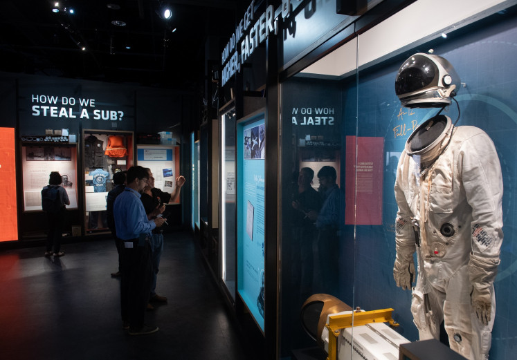Visitors tour the new International Spy Museum during a media preview ahead of its opening in Washington, DC, May 7, 2019.