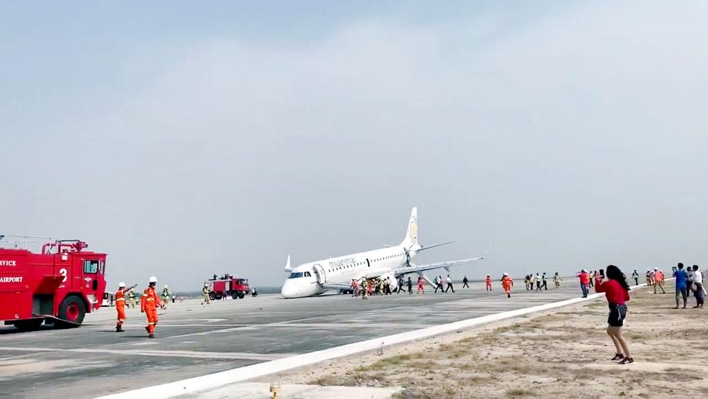 Myanmar plane in emergency touchdown as landing gear fails