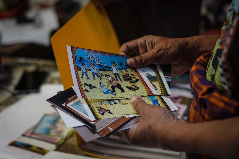 Subandi also creates postcards for his customers. JP/Anggertimur Lanang Tinarbuko