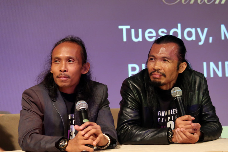 Actors Yayan Ruhian and Cecep Arif Rahman answer questions at a press conference for the movie 'John Wick: Chapter 3 - Parabellum' at the Plaza Indonesia mall in Central Jakarta on Tuesday.