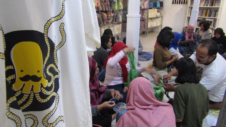 Participants in a knitting class held by Mulyana at Mogus Lab, Yogyakarta, May 12.