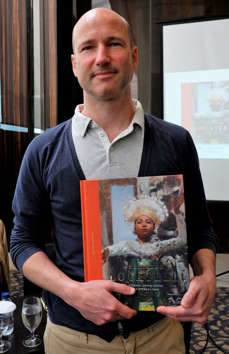 Biography: Author Gianni Orsini  holds his book on Italian artist Romualdo Locatelli. The book includes details on Locatelli's brief yet eventful time in Southeast Asia.