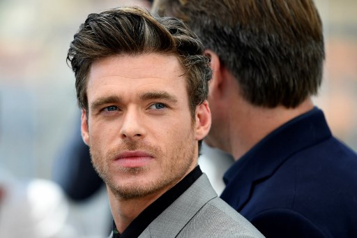 Richard Madden plays 007 peekaboo at Cannes
