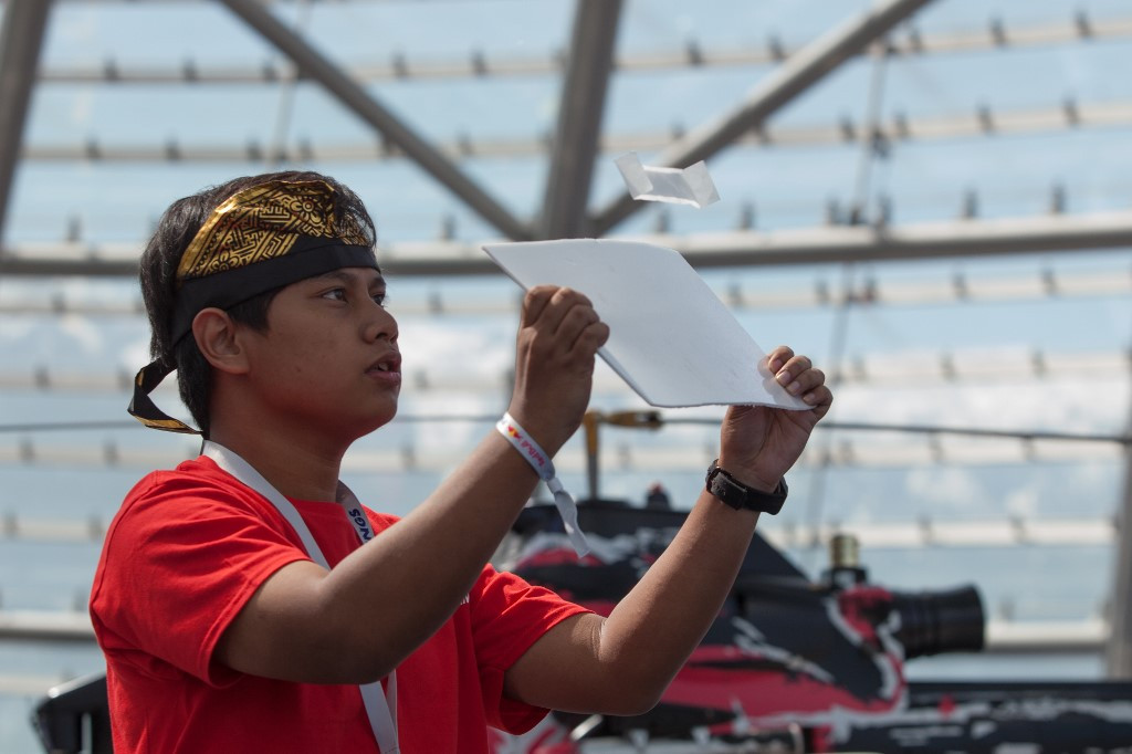 An Indonesian participant in the Red Bull Paper Wings World Finals 2019 competes in Salzburg, Austria on May 17, 2019.