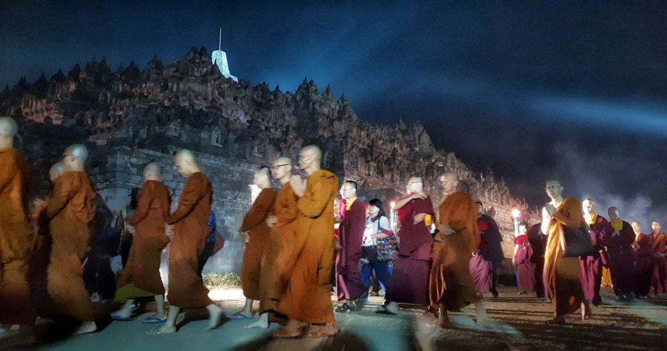 Buddhist monks repeat mantras and meditate as they walk around Borobudur temple in Central Java clockwise three times as part of the Pradaksina ritual in the early hours on Sunday. JP/ R Berto Wedhatama