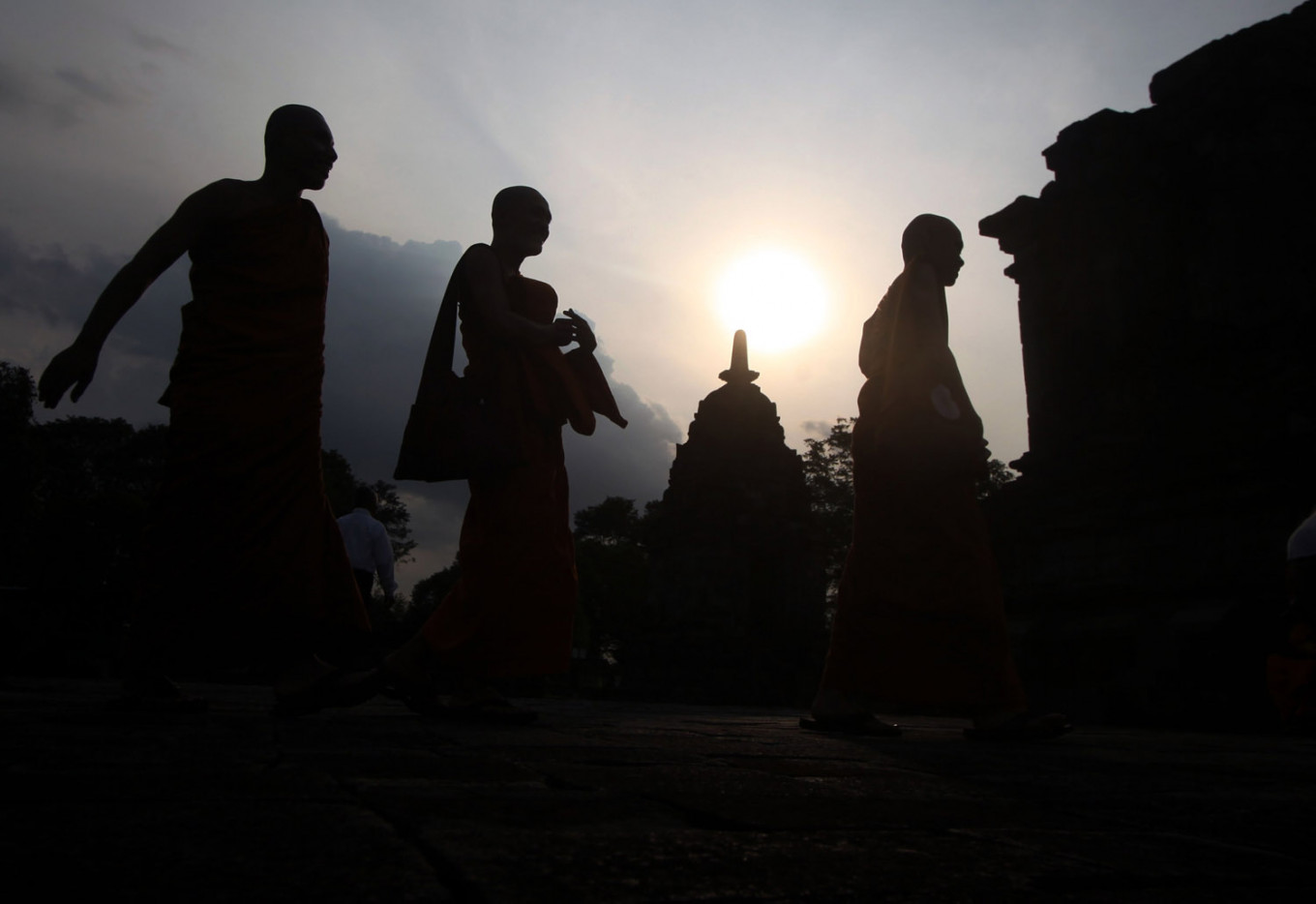 Silhouettes of Buddhist monks at Lumbung Temple in Central Java. JP/Boy T Harjanto