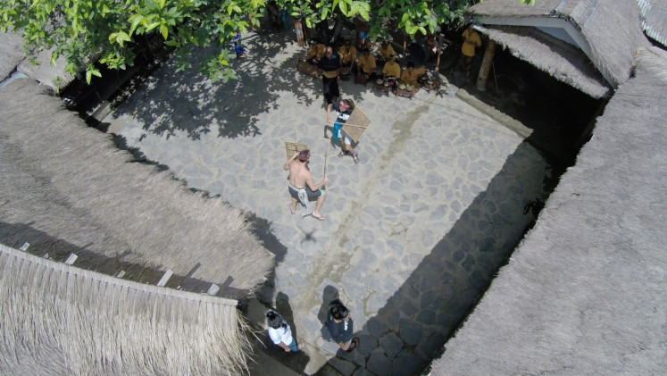 Airy view: A peresean (Sasak stick fight) takes place in Sade village, Lombok, West Nusa Tenggara.