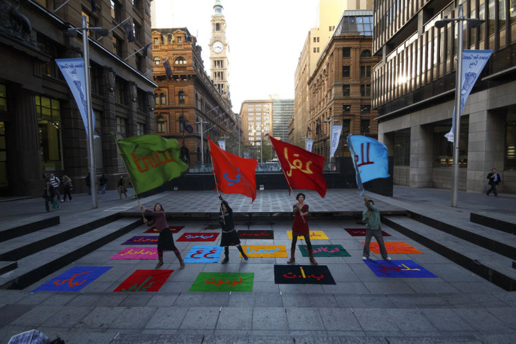 Art and beyond: Flag bearers perform as part of Arahmaiani's Flag Project in Sydney, Australia.