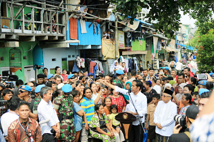 "Five more years: President-elect Joko ""Jokowi"" Widodo is accompanied by running mate Ma'ruf Amin as he delivers a victory speech to residents of Johar Baru in Central Jakarta on Tuesday. The General Elections Commission (KPU) declared late on Monday Jokowi and Ma'ruf winners of the 2019 presidential election with 55.5 percent of the vote, while challengers Prabowo Subianto and running mate Sandiaga Uno received 44.5 percent."
