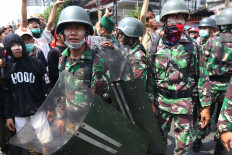 Indonesian Military personnel try to calm the crowd during a protest on Jl.  K.S Tubun, Central Jakarta, on Wednesday. JP/Dhoni Setiawan
