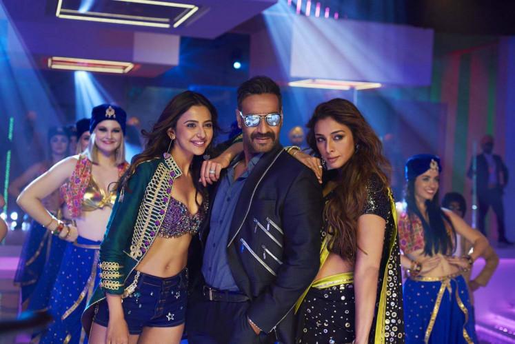 In between: Ashish (Ajay Devgn, center) finds himself between his girlfriend Ayesha Khurana (Rakul Preet Singh, left) and ex-wife Manju (Tabu).