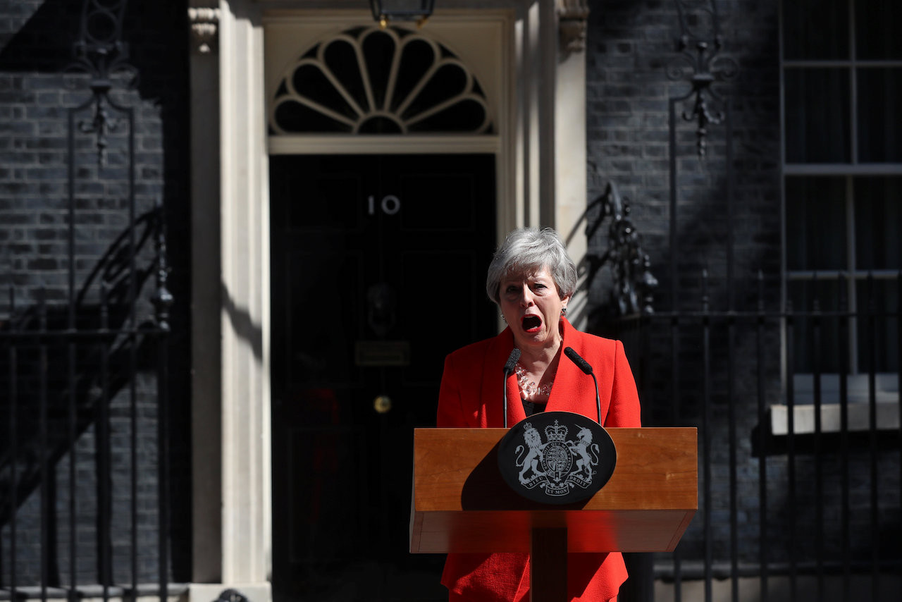Choking back tears, Britain's May says goodbye to Downing Street