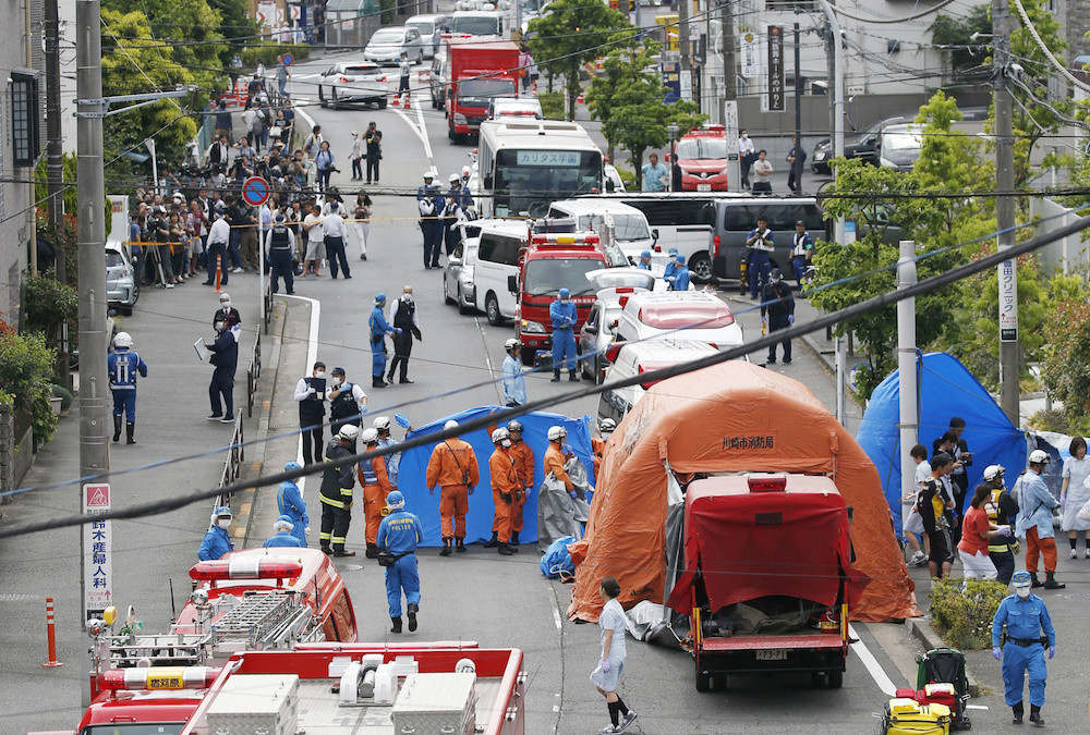 Japan police search home of stabbing attacker