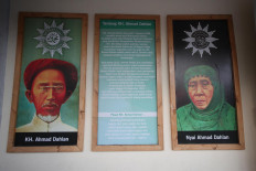 A poster of Ahmad Dahlan and Nyai Ahmad Dahlan on the east gate of Kauman. JP/Boy T. Harjanto