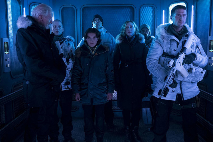 Jonah Alan (left, played by Charles Dance) takes Madison (Millie Bobby Brown) and Emma (Vera Farmiga) as hostages in 'Godzilla'.