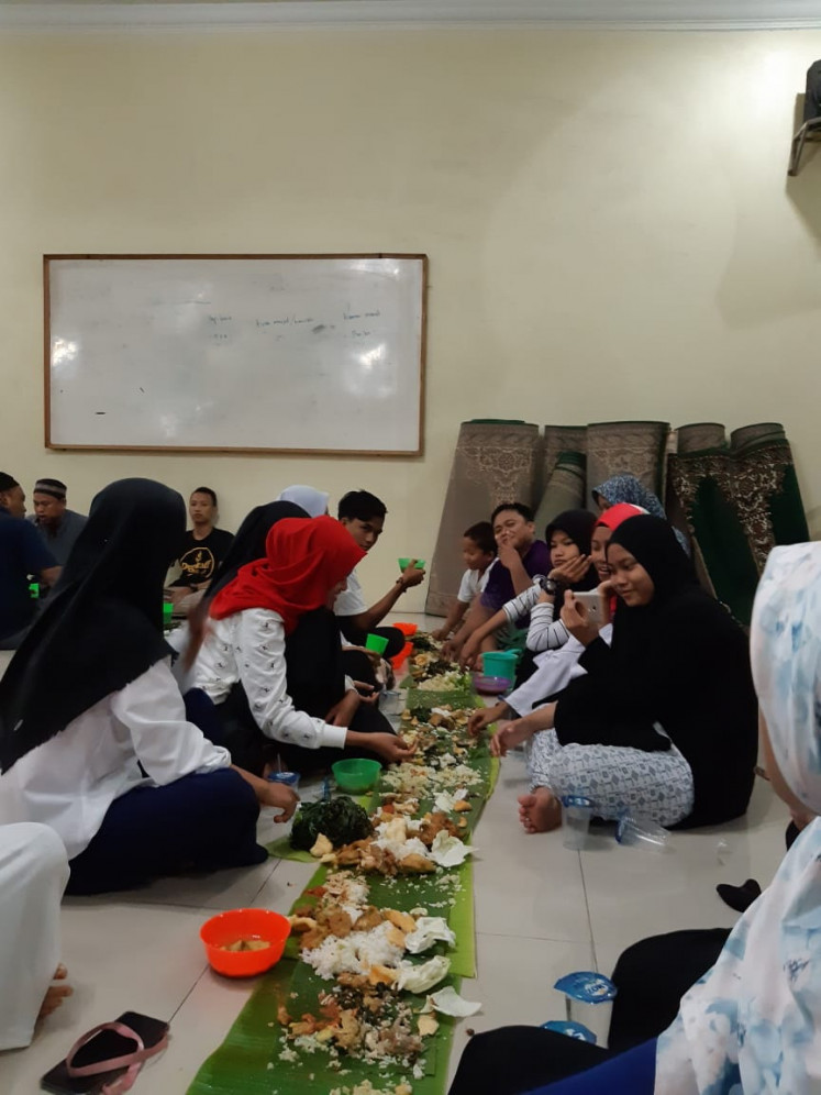 Feast: Members of Al Ikhwan Mosque Youths enjoy a predawn meal together on May 25.