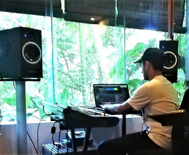 An inspiring view: Producer Tushar Apte at the mixing decks inside the 'secret studio' temporarily installed in his bedroom, edits vocals recorded moments earlier by Lauren Jauregui.