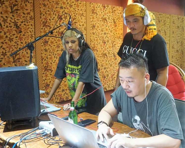 International talent: Edgy punky Melbourne-based singer-songwriter Ecca Vandal (left), LA's own Canadian songwriter August Rigo (center) whose credits include Justin Bieber and One Direction; and Japanese producer Ryosuki Sakai who produced Poppy's eerie futuristic electro sound, work together on something fresh.