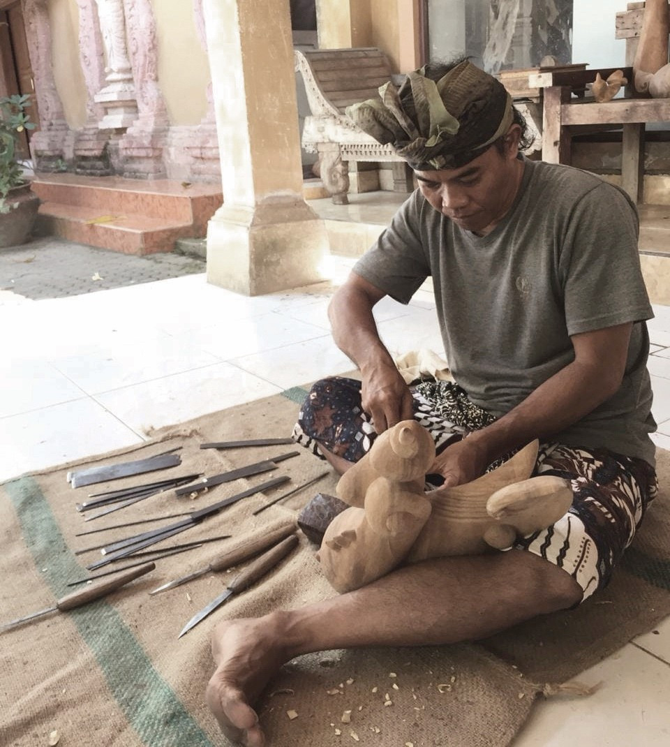 Balinese woodcarver Wayan Jana at work in his Gianyar Studio