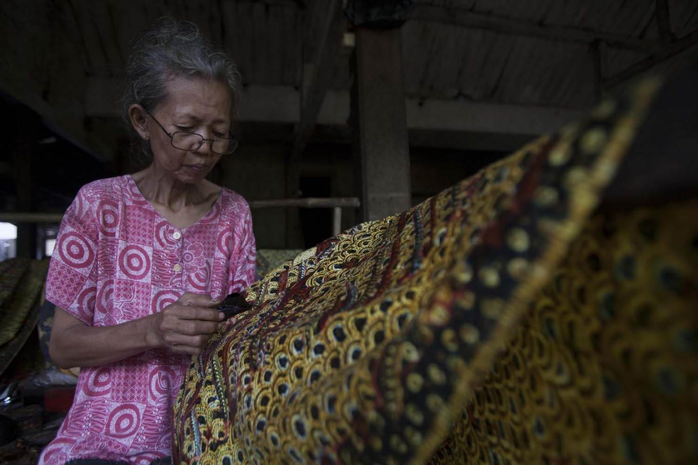 Mbah(grandma) Suti is a 69-year-old batik artist who has been creating batik since 1969.  JP/Sigit Pamungkas