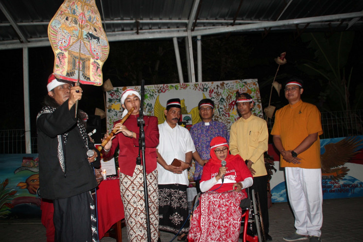 Religious figures gather to pray in a purification ceremony to commemorate Pancasila Day on Saturday in Semarang, Central Java.