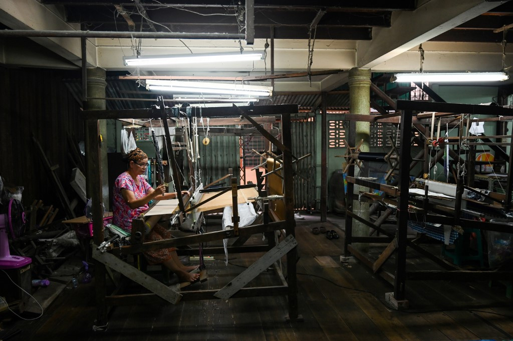 By a thread: Thai Muslim family keeps silk weaving heritage alive