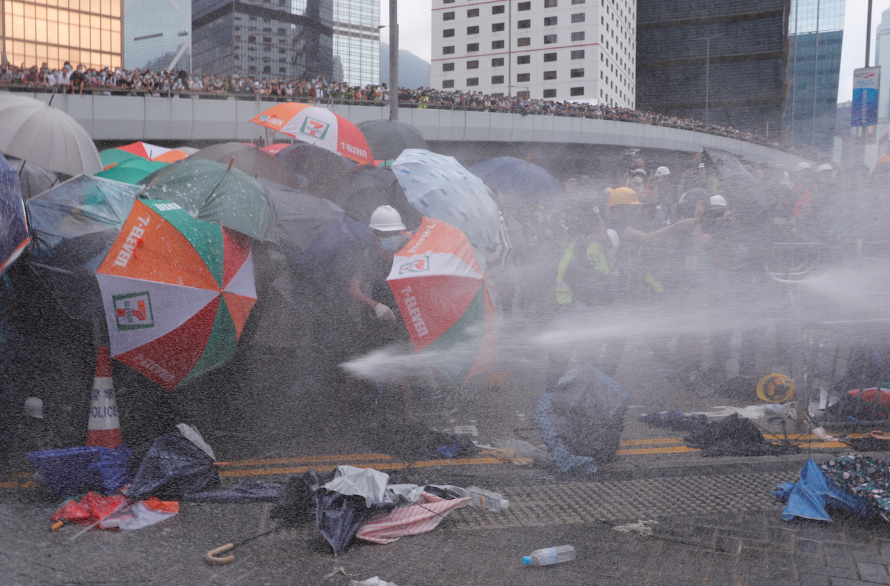 Hong Kong police fire rubber bullets as protests turn to violent chaos