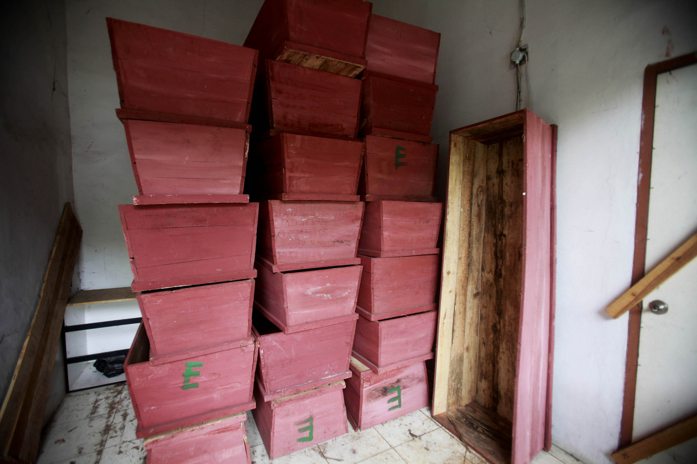 Stacked high: The red coffins at the Petamburan Cemetery office in Central Jakarta are reserved for unidentified bodies found by the Palang Hitam team. JP/Iqbal Yuwansyah