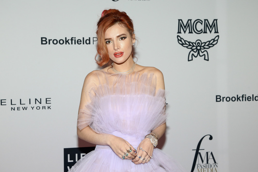 Actress Bella Thorne defies hacker by releasing topless photographs herself