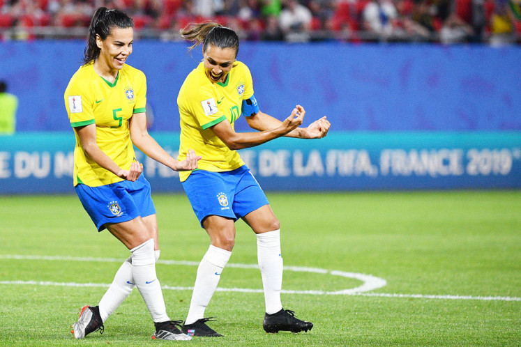 High call: Brazil's forward Marta (right) celebrates with teammate Thaisa after scoring a goal during the 2019 Women's World Cup Group C soccer match between Italy and Brazil on Tuesday, at the Hainaut Stadium in Valenciennes, France.
