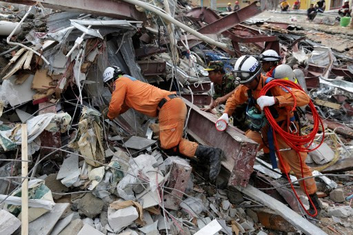Rescuers scour rubble as Cambodia building collapse toll rises to 18