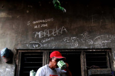 A worker enjoys his tea. JP/Maksum Nur Fauzan