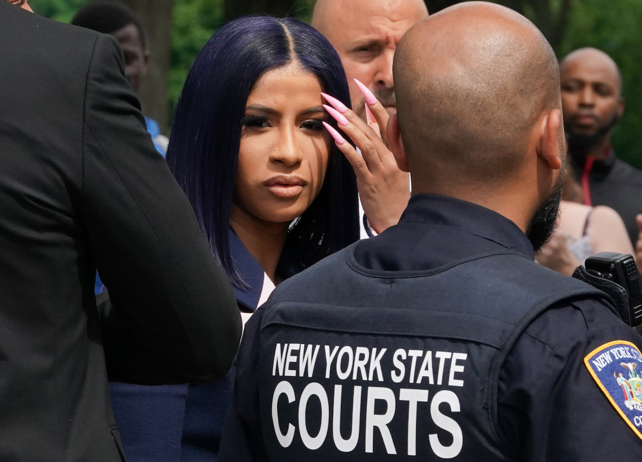 Rapper Cardi B denies strip club brawl charges