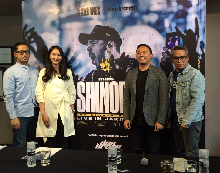 Warner Music Indonesia representative Aquilla Aditya (left to right), Widelanes spokesperson Tania Rizqia, Beatnation Asia CEO Abe Aditya and music observer Adib Hidayat pose at a press conference on Mike Shinoda's upcoming Jakarta concert on Wednesday.