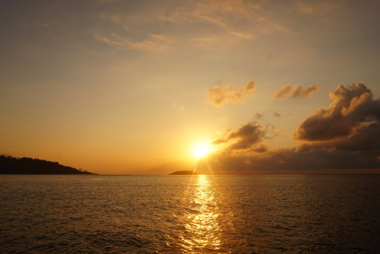 Sunrise as seen from large 'jukung'-style outrigger during the Sunrise Cruise.