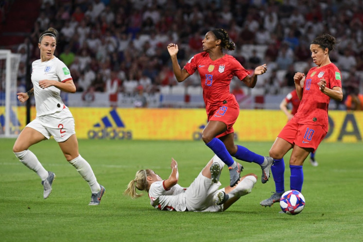 United States' defender Crystal Dunn (2R) vies for the ball with England's defender Steph Houghton (down) during the France 2019 Women's World Cup semi-final football match between England and USA, on July 2, 2019, at the Lyon Satdium in Decines-Charpieu, central-eastern France.