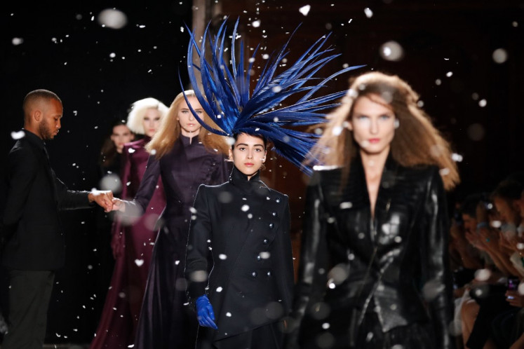Models present creations by Julien Fournie during the Women's Fall-Winter 2019/2020 Haute Couture collection fashion show in Paris, on July 2, 2019.