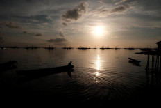 Waterworld: A Tanjung Binga villager sets sail on the waters of Belitung Island. JP/Donny Fernando