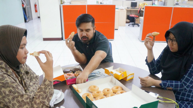 The tasting panel for Jakpost's donuts taste test.
